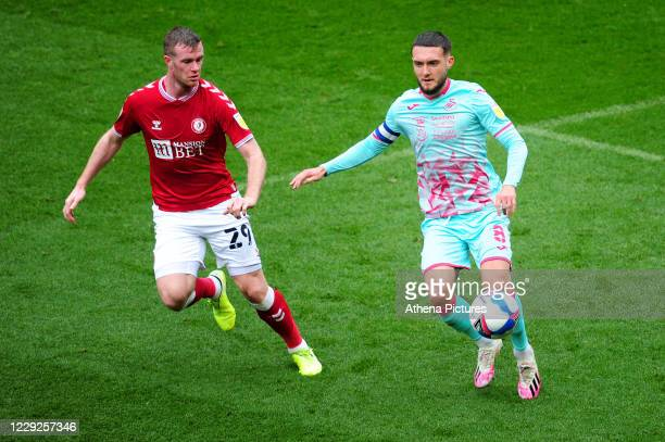 Chris Brunt of Bristol City vies for possession with Matt Grimes of Swansea City during the Sky Bet Championship match between Bristol City and...
