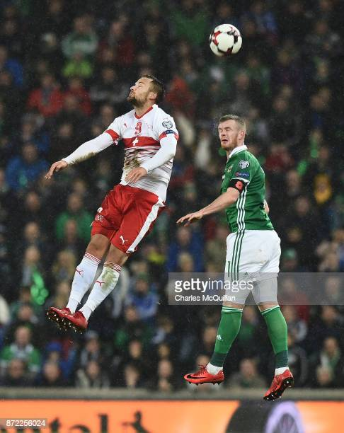 Chris Brunt of Northern Ireland and Haris Seferovic of Switzerland during the FIFA 2018 World Cup Qualifier PlayOff first leg between Northern...