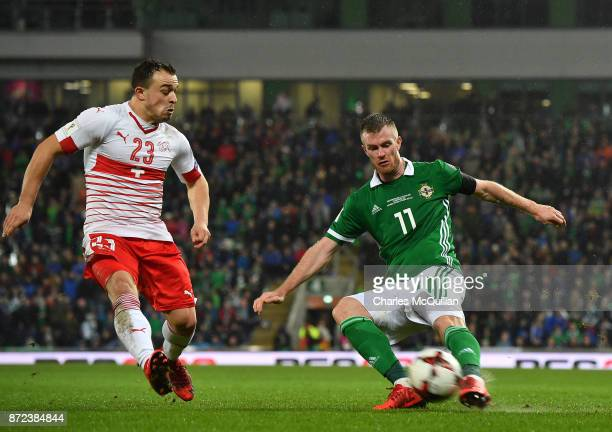 Chris Brunt of Northern Ireland and Xherdan Shaqiri of Switzerland during the FIFA 2018 World Cup Qualifier PlayOff first leg between Northern...