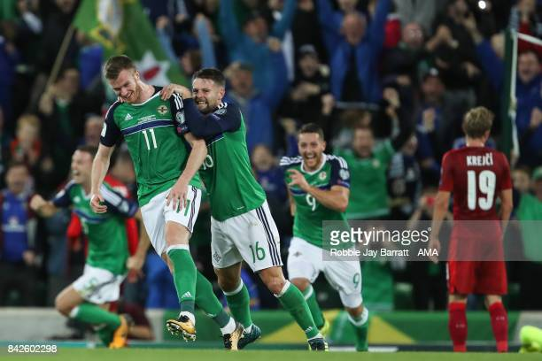 Chris Brunt of Northern Ireland celebrates after scoring a goal to make it 20 during the FIFA 2018 World Cup Qualifier between Northern Ireland and...