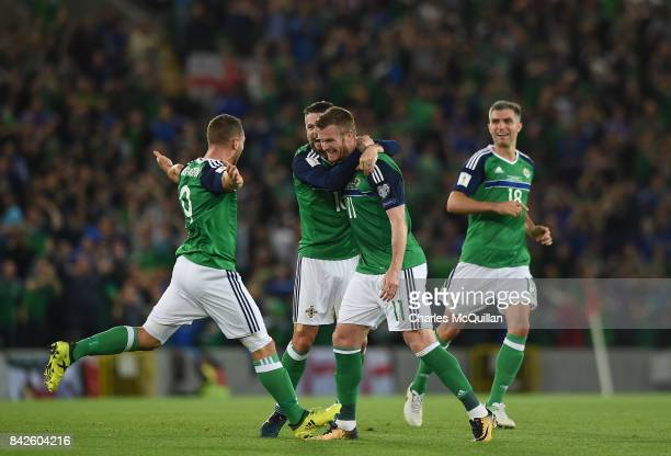 Chris Brunt of Northern Ireland celebrates after scoring his sides second goal during the FIFA 2018 World Cup Qualifier between Northern Ireland and...