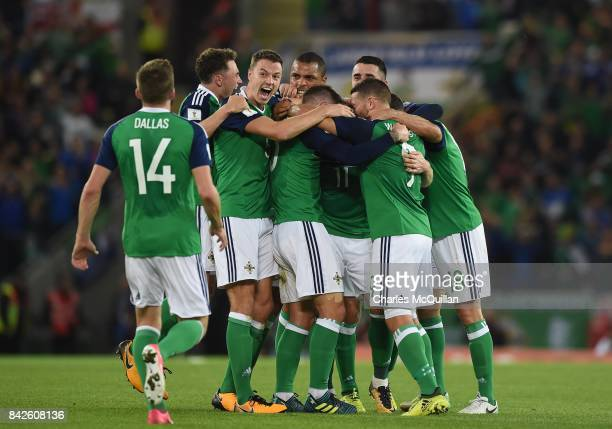 Chris Brunt of Northern Ireland celebrates with his teammates after scoring their second goal during the FIFA 2018 World Cup Qualifier between...
