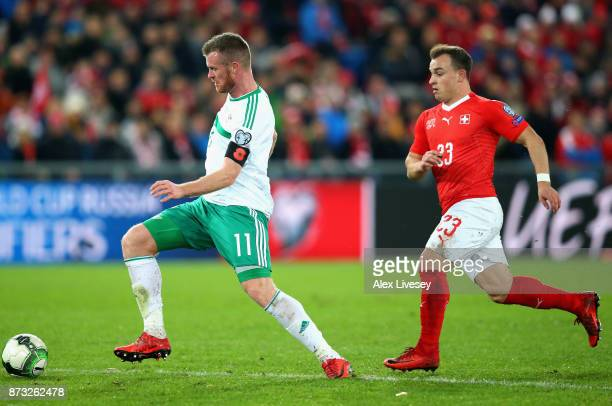Chris Brunt of Northern Ireland is chased down by Xherdan Shaqiri of Switzerland during the FIFA 2018 World Cup Qualifier PlayOff Second Leg between...