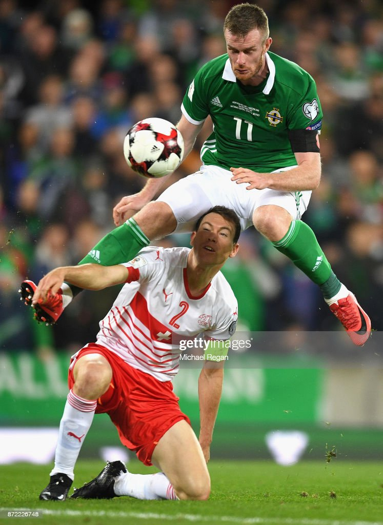 Chris Brunt of Northern Ireland rides a challange from Stephan Lichtsteiner of Switzerland during the FIFA 2018 World Cup Qualifier Play-Off: First Leg between Northern Ireland and Switzerland at Windsor Park on November 9, 2017 in Belfast, Northern Ireland.
