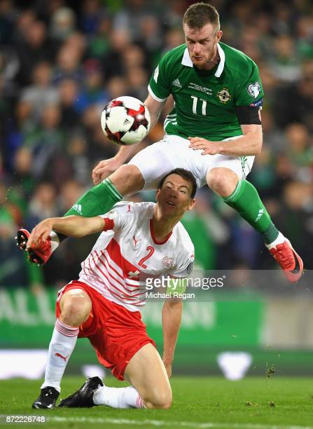 Chris Brunt of Northern Ireland rides a challange from Stephan Lichtsteiner of Switzerland during the FIFA 2018 World Cup Qualifier PlayOff First Leg...