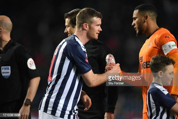 Chris Brunt of WBA and Jamaal Lascelles shake hands prior to the FA Cup Fifth Round match between West Bromwich Albion and Newcastle United at The...
