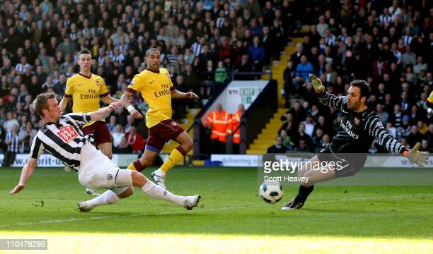 Chris Brunt of WBA shoots past Arsenal's Manuel Almunia during the Barclays Premier League match between West Bromwich Albion and Arsenal at The...