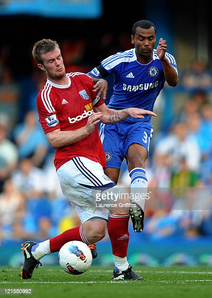Chris Brunt of West Brom and Ashley Cole of Chelsea compete for the ball during the Barclays Premier League match between Chelsea and West Bromwich...