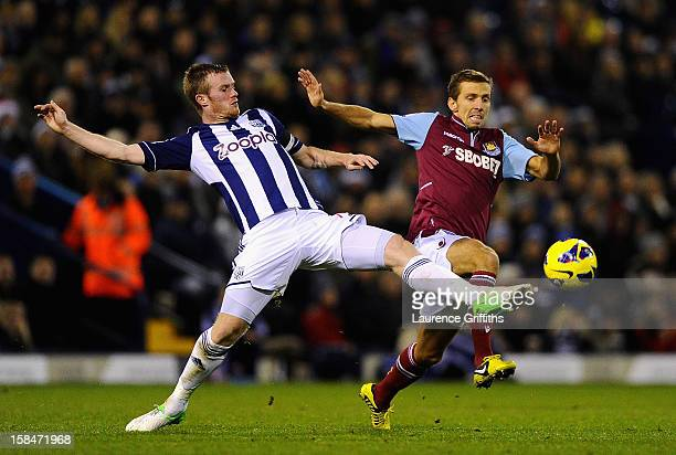 Chris Brunt of West Brom battles with Gary O'Neil of West Ham during the Barclays Premiership match between West Bromwich Albion and West Ham United...