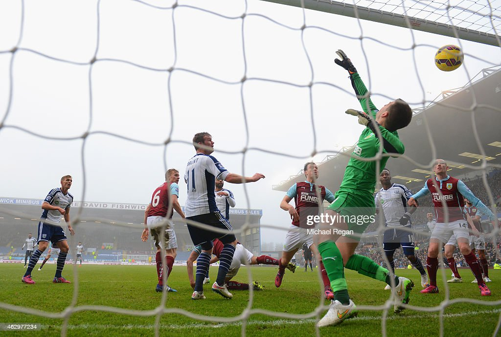 Chris Brunt of West Brom scores their first goal past Thomas Heaton of Burnley during the Barclays Premier League match between Burnley and West Bromwich Albion at Turf Moor on February 8, 2015 in Burnley, England.