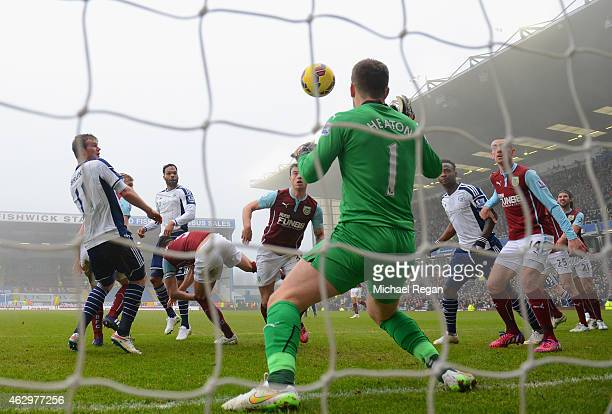 Chris Brunt of West Brom scores their first goal past Thomas Heaton of Burnley during the Barclays Premier League match between Burnley and West...