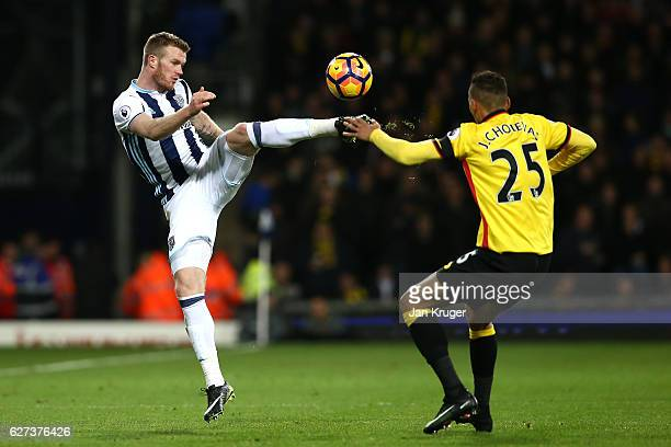 Chris Brunt of West Bromwich Albion abd Jose Holebas of Watford compete for the ball during the Premier League match between West Bromwich Albion and...