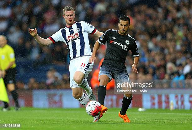 Chris Brunt of West Bromwich Albion and Pedro of Chelsea during the Barclays Premier League match between West Bromwich Albion and Chelsea on August...