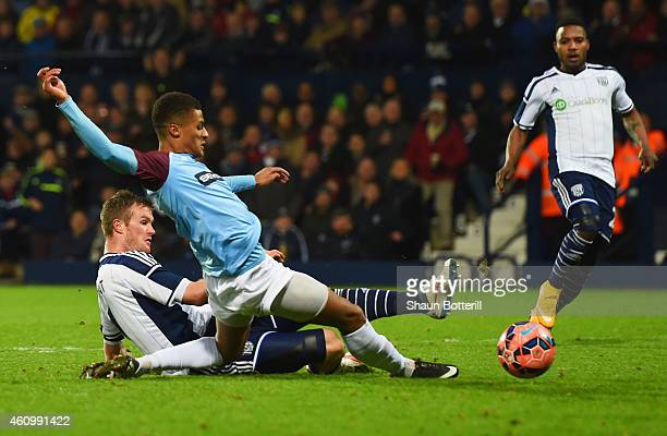 Chris Brunt of West Bromwich Albion beats Andrai Jones of Gateshead to score their fifith goal during the FA Cup Third Round match between West...