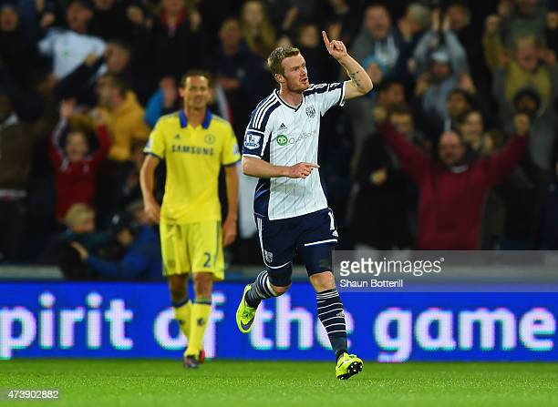 Chris Brunt of West Bromwich Albion celebrates as he scores their third goal during the Barclays Premier League match between West Bromwich Albion...