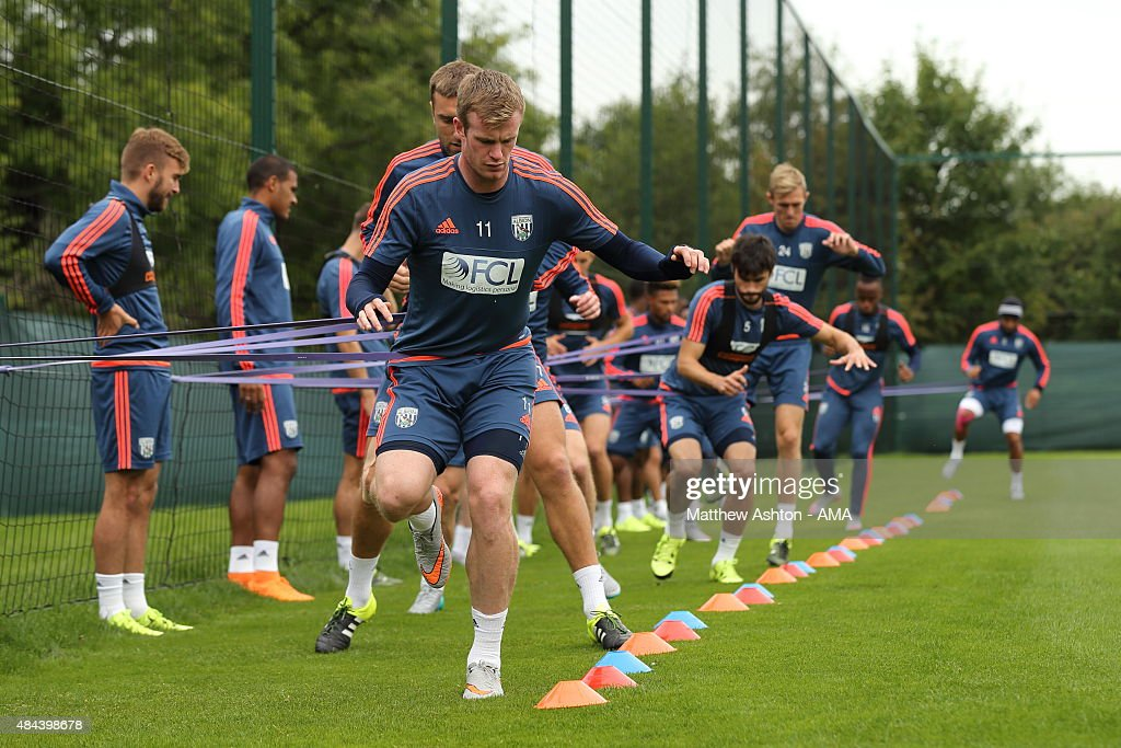 Chris Brunt of West Bromwich Albion doing exercises with elastic bands during the West Bromwich Albion training session at West Bromwich Albion Training Ground on August 18, 2015 in Walsall, England.