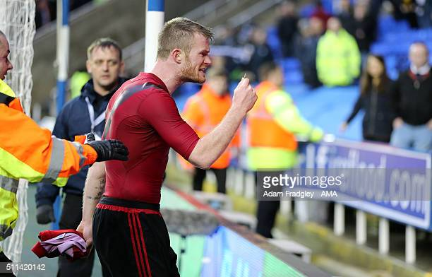 Chris Brunt of West Bromwich Albion is held back by stewards as he holds up the coin which was thrown at him after the Emirates FA Cup match between...