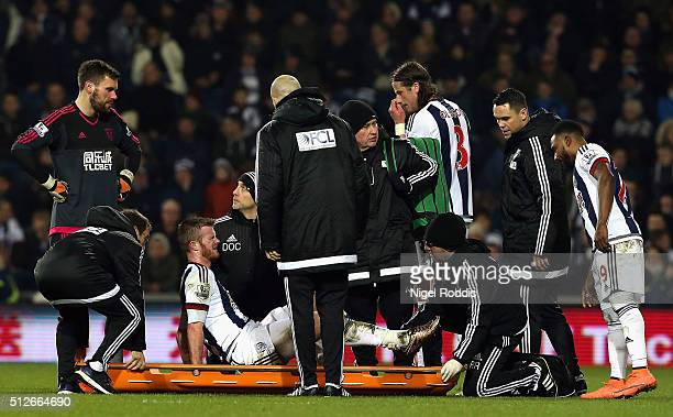 Chris Brunt of West Bromwich Albion is taken to a stretcher during the Barclays Premier League match between West Bromwich Albion and Crystal Palace...
