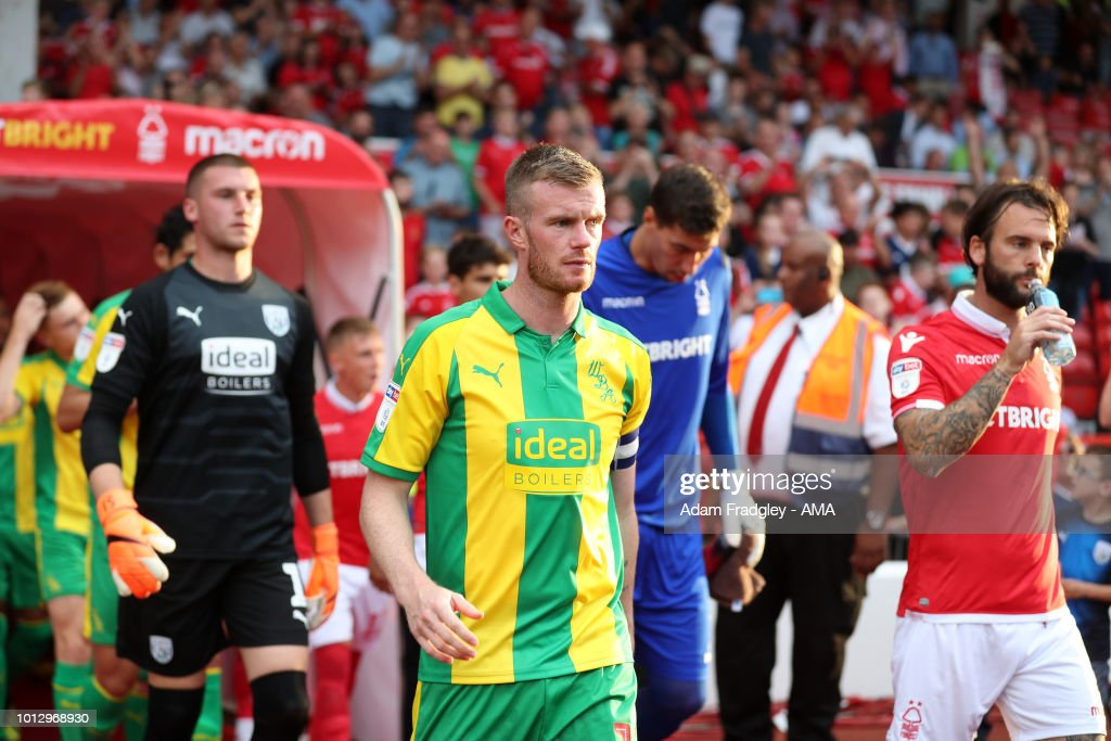 Chris Brunt of West Bromwich Albion leads the team out during the Sky Bet Championship match between Nottingham Forest v West Bromwich Albion at City Ground on August 7, 2018 in Nottingham, England.