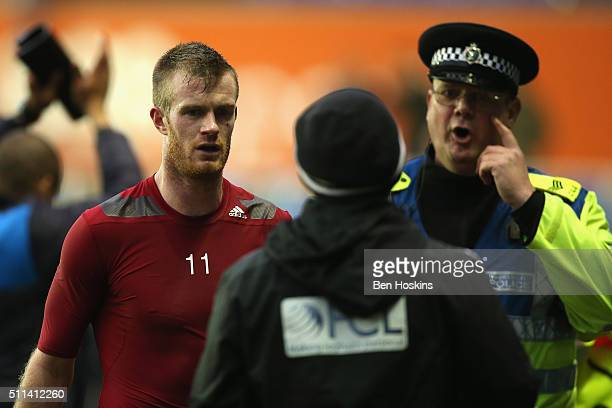 Chris Brunt of West Bromwich Albion leaves the field after being hit by an object during the Emirates FA Cup fifth round match between Reading and...