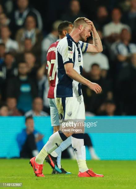 Chris Brunt of West Bromwich Albion reacts as he is sent off during the Sky Bet Championship Playoff semi final second leg match between West...