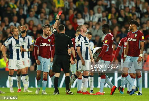 Chris Brunt of West Bromwich Albion reacts as he is shown a red card by referee Chris Kavanagh and is sent off during the Sky Bet Championship...