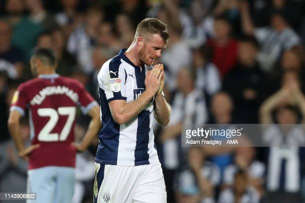 Chris Brunt of West Bromwich Albion reacts as he leaves the field for being shown a red card during the Sky Bet Championship Playoff Semi Final...