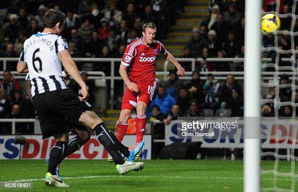 Chris Brunt of West Bromwich Albion scores his team's first goal during the Barclays Premier League match between Newcastle United and West Bromwich...