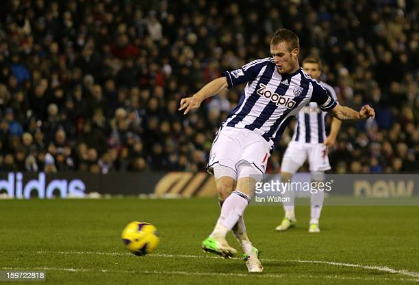 Chris Brunt of West Bromwich Albion scores their first goal during the Barclays Premier League match between West Bromwich Albion and Aston Villa at...