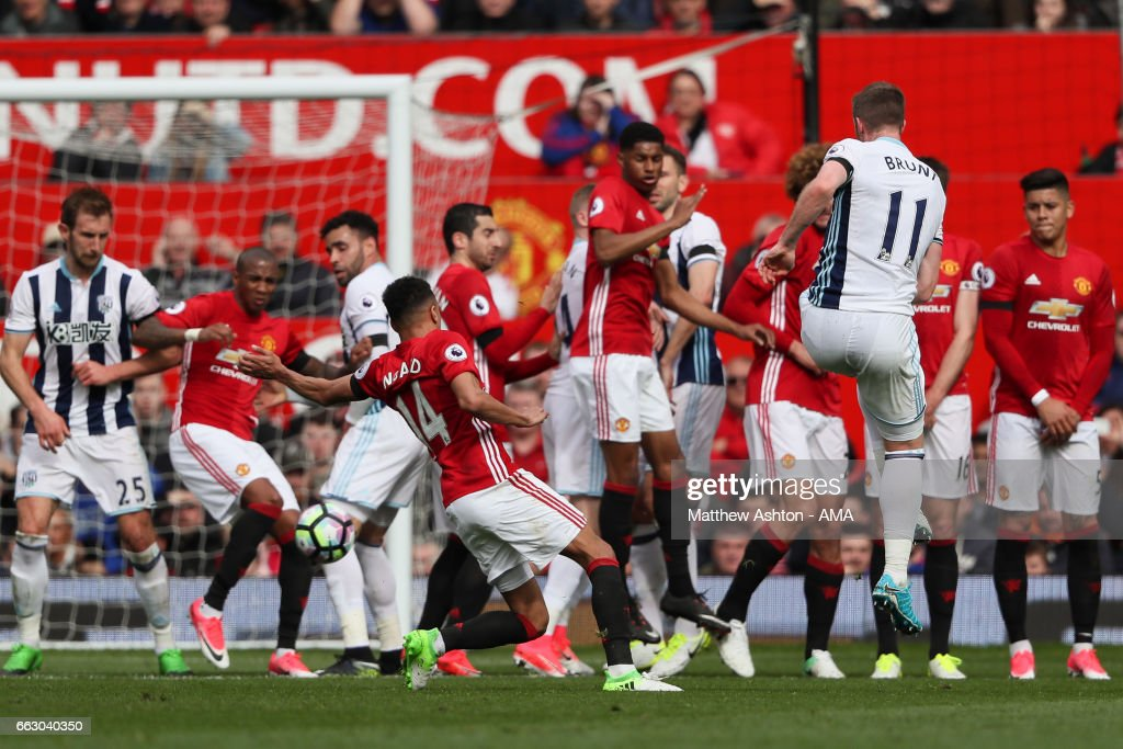 Chris Brunt of West Bromwich Albion sees his free kick blocked during the Premier League match between Manchester United and West Bromwich Albion at Old Trafford on April 1, 2017 in Manchester, England.