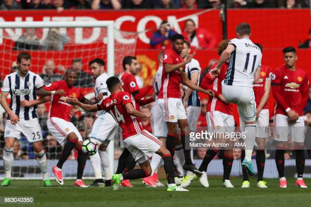 Chris Brunt of West Bromwich Albion sees his free kick blocked during the Premier League match between Manchester United and West Bromwich Albion at...