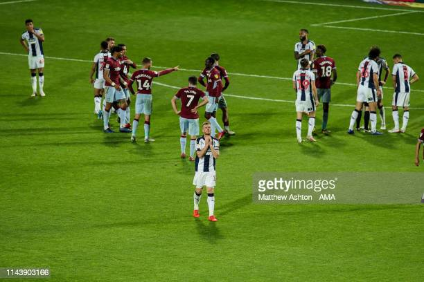 Chris Brunt of West Bromwich Albion walks off the pitch after receiving a red card during the Sky Bet Championship Playoff Semi Final Second Leg...