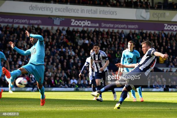 Chris Brunt of West Bromwich scores his team's second goal during the Barclays Premier League match between West Bromwich Albion and Tottenham...