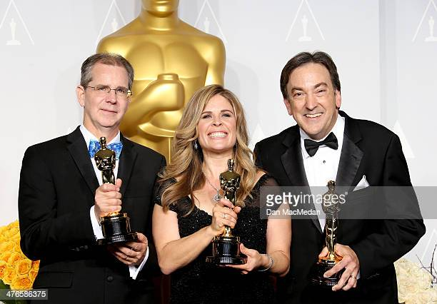 Chris Buck Jennifer Lee and Peter Del Vecho winners of Best Animated Feature Film of the Year for Frozen in the press room at the 86th Annual Academy...