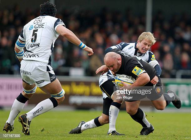 Chris Budgen of Exeter Chiefs crashes into Mathew Tait of Sale Sharks during the Aviva Premiership match between Exeter Chiefs and Sale Sharks at...