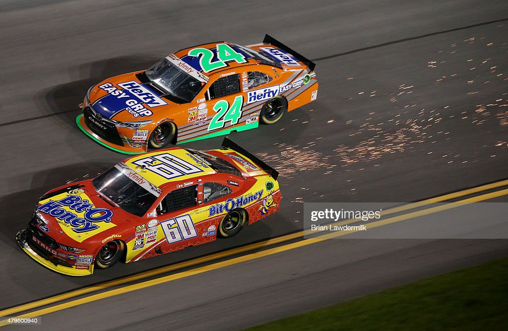 Chris Buescher, driver of the #60 Bit-O-Honey Ford, leads Eric McClure, driver of the #24 Hefty Easy Grip Cups Toyota, during the NASCAR XFINITY Series Subway Firecracker 250 Powered By Coca-Cola at Daytona International Speedway on July 4, 2015 in Daytona Beach, Florida.