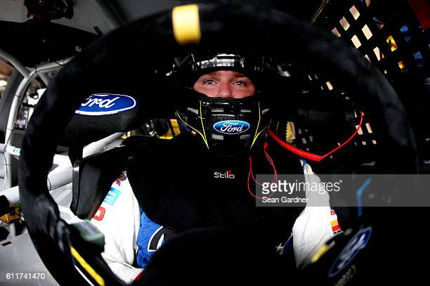 Chris Buescher driver of the CSX Play it Safe Ford sits in his car during practice for the NASCAR Sprint Cup Series Citizen Solider 400 at Dover...