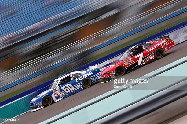 Chris Buescher driver of the Fastenal Ford and Regan Smith driver of the TaxSlayercom Chevrolet race during the NASCAR XFINITY Series Ford EcoBoost...