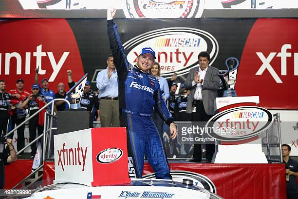 Chris Buescher driver of the Fastenal Ford celebrates winning the series championship in Victory Lane after the NASCAR XFINITY Series Ford EcoBoost...