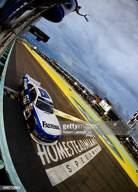 Chris Buescher driver of the Fastenal Ford crosses the finish line to win the series championship after the NASCAR XFINITY Series Ford EcoBoost 300...