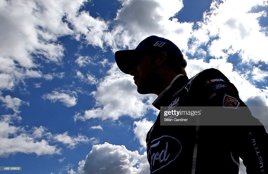 Chris Buescher, driver of the #60 Fifth Third Bank Ford, walks on the grid during qualifying for the NASCAR XFINITY Series FURIOUS 7 300 at Chicagoland Speedway on September 19, 2015 in Joliet, Illinois.