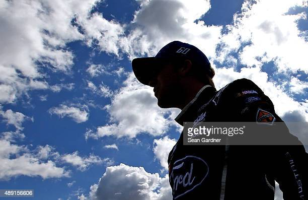 Chris Buescher driver of the Fifth Third Bank Ford walks on the grid during qualifying for the NASCAR XFINITY Series FURIOUS 7 300 at Chicagoland...