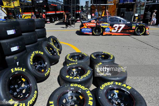 Chris Buescher driver of the Kroger Thrill of the Grill Chevrolet drives through the garage during practice for the Monster Energy NASCAR Cup Series...