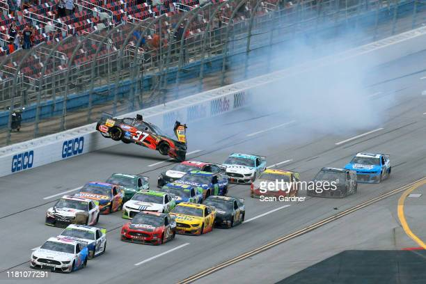 Chris Buescher driver of the Louisiana Hot Sauce Chevrolet is involved in an ontrack incident on the last lap of the Monster Energy NASCAR Cup Series...