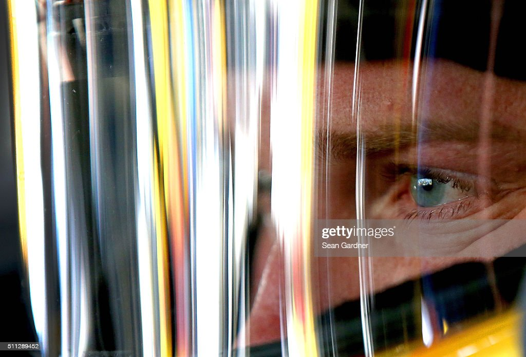 Chris Buescher, driver of the #34 Love's Travel Stops Ford, sits in his car during practice for the NASCAR Sprint Cup Series Daytona 500 at Daytona International Speedway on February 19, 2016 in Daytona Beach, Florida.