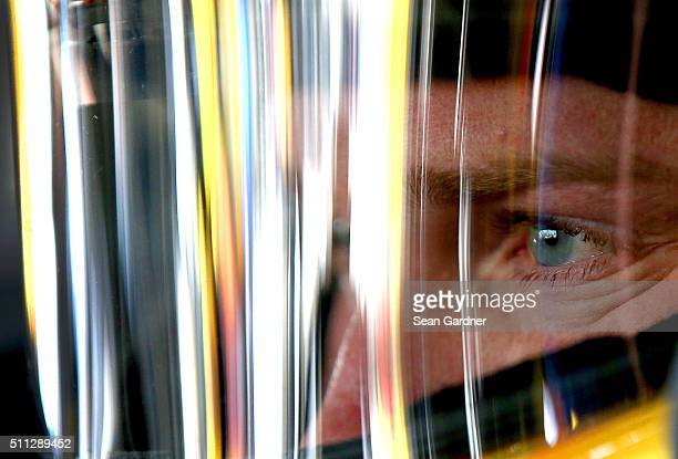 Chris Buescher driver of the Love's Travel Stops Ford sits in his car during practice for the NASCAR Sprint Cup Series Daytona 500 at Daytona...