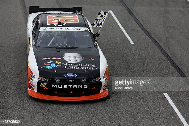 Chris Buescher driver of the Nationwide Children's Hospital Ford Mustang Ford celebrates winning the Nationwide Children's 200 at MidOhio Sports Car...
