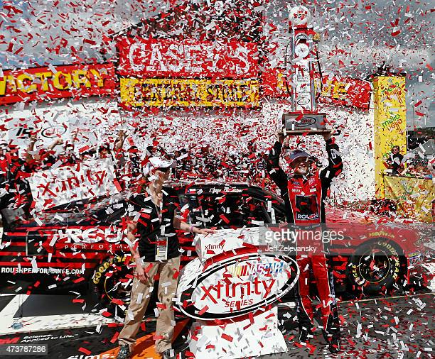 Chris Buescher driver of the Roush Performance Products Ford celebrates in victory lane after winning during the NASCAR XFinity Series 3M 250 at Iowa...