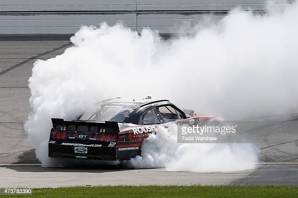 Chris Buescher driver of the Roush Performance Products Ford celebrates with a burn out after winning the NASCAR XFinity Series 3M 250 at Iowa...