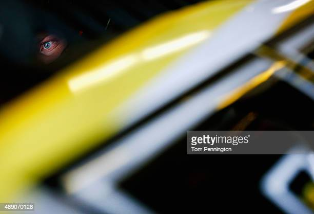 Chris Buescher driver of the SafetyKleen Ford sits in his car in the garage during practice for the NASCAR XFINITY Series O'Reilly Auto Parts 300 at...